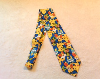 Necktie or clip on tie made from Pokemon Characters tossed on blue