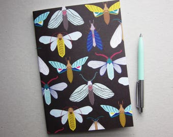 Dark moths pattern notebook A5, hand drawn illustration by MaggieMagoo Designs. Designed & printed in the UK.