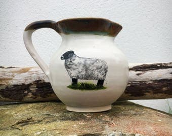 Pottery milk jug, pitcher with sheep