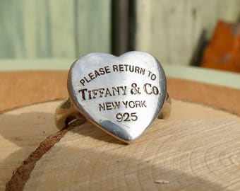 Sold to Steve, Layaway 1, A silver heart shaped Tiffany & Co ring.