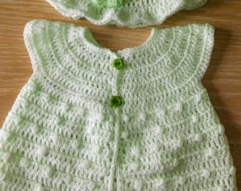 crocheted short sleeved cardigan and matching hat