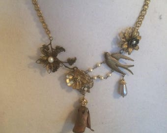 Necklace made from varied pieces of vintage jewelry repurposed.