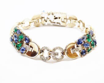 1950s Crown Trifari Jeweled Symphony Alfred Philippe Rhinestone Trifarium Bracelet Sapphire Blue Emerald Green Gold