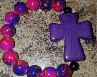 Pink and purple beaded purple cross bracelet