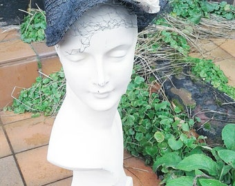 Cute 1930s navy straw cloche style hat with veil and flower decoration