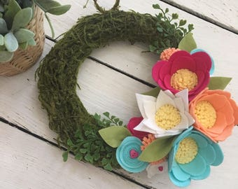 Mossy wreath with bright blooms