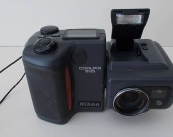 A Vintage  NIKON Coolpix 990  checked in working condition, with accessories and instruction Manuals plus CDs, including PHOTOSHOP unopened,