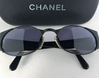 Chanel Authentic vintage black oval sunglasses, circa 1995, adjustable nose pads