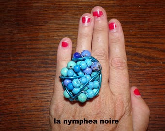large ring with seed beads large format on transparent glass turquoise ceramic beads