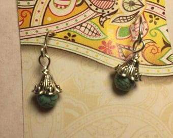 Tiny little turquoise beads in silver beadcaps hanging on small sterling round earwires.