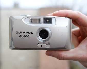 Olympus Go 100 - Compact Camera with Built-in-Flash - Point and Shoot Camera