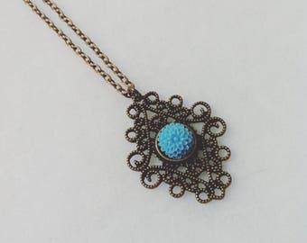 blue flower cabochon bronze pendant necklace