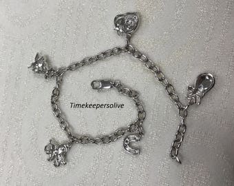 a160 Very Pretty 10k White Gold Bracelet with Charms and Diamonds tcw is .12