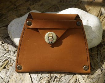 wallet brown leather with a wooden button
