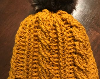 Cable knit hat with fur pom-pom