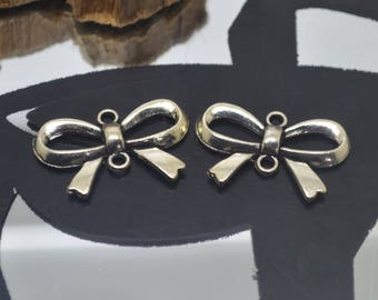 2 spacer silver charm 2x1.5 cm bows