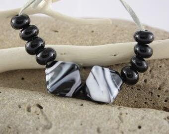 Assorted black and white worked glass bead