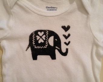 Hand printed baby onesie