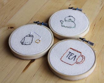 """Ornaments or decorations for the tea lover, mug, tea bag, and kettle, 3"""" hand embroidered original artwork, as a set or sold separately"""