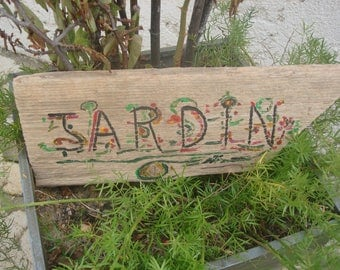 wood found on the beach, Garden direction sign