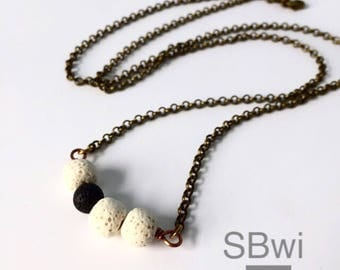 Mineral necklace in bronze and copper with quartz, carnelian and turquoise details