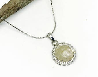Faceted Rutilated Quartz and white topaz pendant set in sterling silver 925. All stones are natural and authentic . 16mm round.