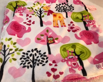 Cute baby blankie - animals on very soft minky with a pink swirl minky on the back.