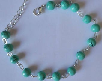Bracelet - 21 cm green marbled beads