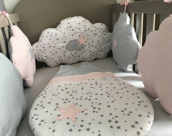 Baby bumper in the shape of grey, pink and white clouds with stars