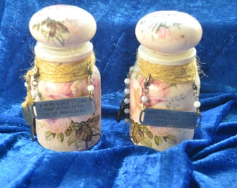 A stunning pair of hand decorated decoupaged, mixed media bottle/jars