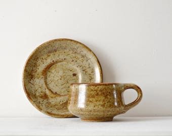 Aylesford pottery cup and saucer set made by Colin Pearson in the 1950's. Collectable ceramics with a beautiful crackled oxidised glaze.