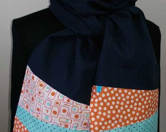 Scarf in blue/black fabric with blue, white and orange tips.