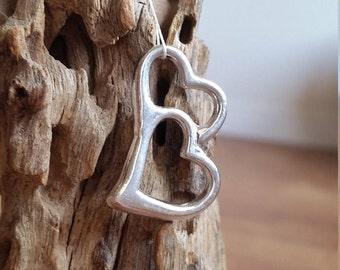 Double open heart cast pendant