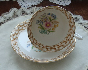 Royal Albert Crown China Made in England - Vintage Tea Cup and Saucer - Band 0f Brown/White Wicker with Various Flowers and a Blue Ribbon