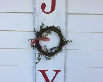 Rustic JOY wood sign.  Hand painted and stained with lettering done in christmas red!  Comes with wreath and bow.  Ready to ship!