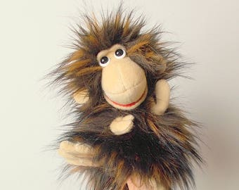 Marmoset. Monkey actress. Bibabo. Marionette. Toy on hand. Toy glove. Puppet theatre.