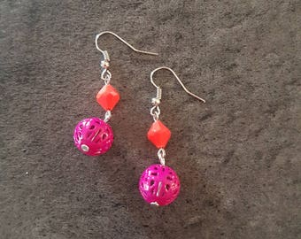Earrings openwork and plastic beads