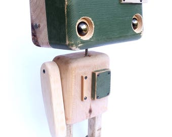 Robot made of recycled wood - green head