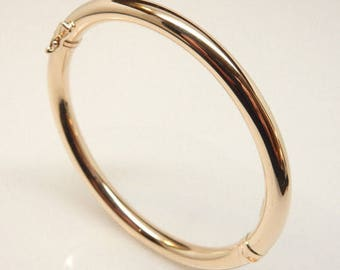 Plain hollow 14k solid gold  tube bangle bracelet 8.8g