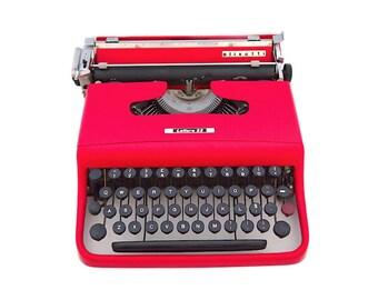 Olivetti lettera 22 typewriter, 1957, red typewriter, working typewriter, portable typewriter, Olivetti, vintage typewriter, qwerty.
