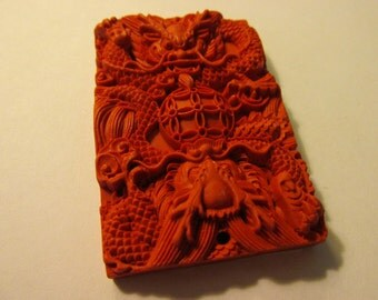 "Red Cinnabar Pendant of Two Mythical Dragons, 2 1/4"" x 1 1/2"""