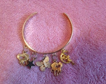 Gold finish  Charm Bracelet - with five mythical charms