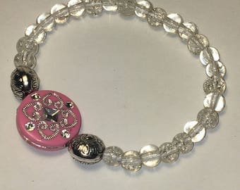 Clear sparkly stretch bracelet with pink centerpiece and silver accent beads. Stretchy One Size