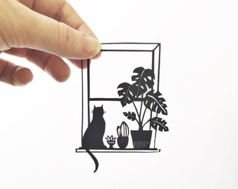 Handmade papercut | window | papercut | cat | silhouette | plants | home | wall art | illustration | cheese plant | monstera Deliciosa