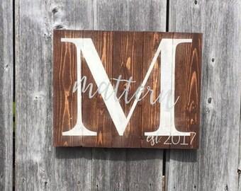 established last name sign