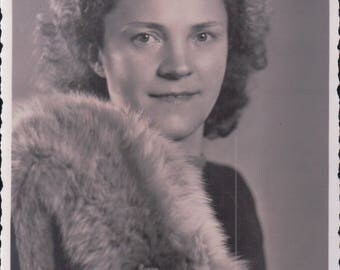 Studio Portrait Photograph of a Young Woman in Her Furs.