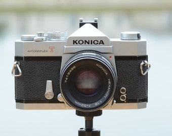 Vintage Konica Autoreflex T 35mm SLR film camera with 52mm f/1.8 Konica Hexanon prime lens