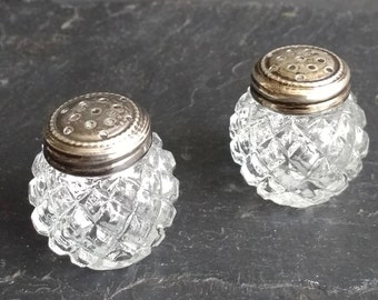Small salt  and pepper in carved glass and sterling silver