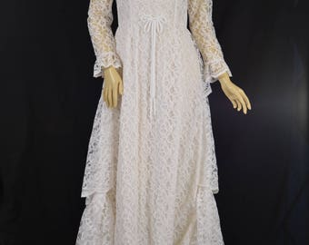 1950s styled lace dress with tiered back skirt