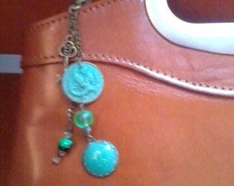 Neon turquoise dragon handbag